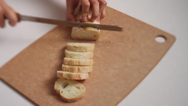 CU Shot of cutting Bread of Baguette / Seoul, South Korea