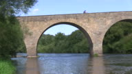 MS Shot of Cyclist at old Sauer Bridge / Dillingen, Echternach, Luxembourg