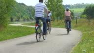 MS Shot of cyclists on bikeway at Saar Valley / Saarburg, Rhineland Palatinate, Germany