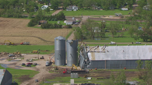 CU AERIAL TS ZO Shot of Damage silo and quick pull out to downtown / Edgar, Nebraska, United States