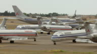 MS AERIAL Shot of decommissioned American Airlines airplanes sitting on tarmac / Roswell, New Mexico, United States