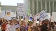 MS TU Shot of demonstrators holding out signs in favor of marriage equality during rally in front of Supreme Court building / Washington, District of Columbia, United States