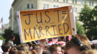 CU ZO Shot of demonstrators saying JUST=MARRIED sign during rally for marriage equality / Washington, District of Columbia, United States