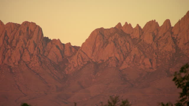 MS PAN Shot of Desert peaks of Organ Mountains during sunset / Las Cruces, New Mexico, United States