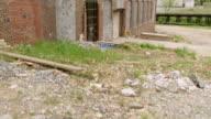 MS TU Shot of dilapidated facade of Revolution Cotton Mills / Greensboro, North Carolina, United States