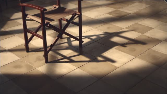 Shot of Director's Chair in Shadow