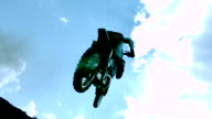 MS SLO MO LA TS Shot of dirt biker riding and jumping with legs up in air / Venice, California, United States