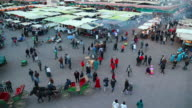 MS Shot of Djemaa el Fna square at dusk with people moving / Marrakech, Morocco