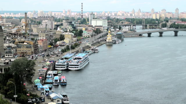 WS T/L Shot of dnipro river with cars and city / Kiev, Ukraine