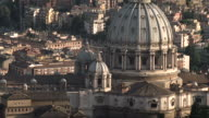 WS AERIAL Shot of dom of Saint Peters Basilica and city  / Rome, Italy