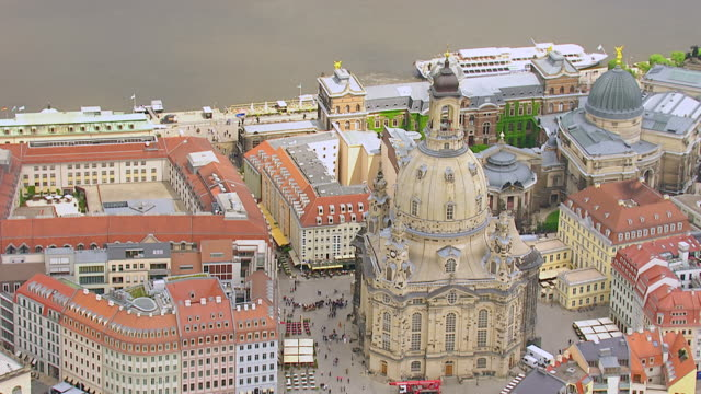 MS AERIAL TS Shot of Dome of Frauenkirche church with pedestrian and river in city / Dresden, Saxony, Germany