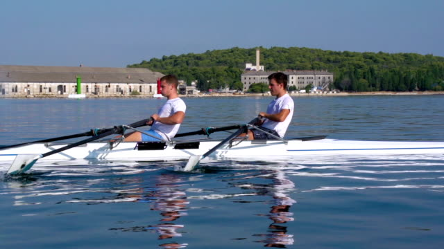 HD: Shot of Double scull rowing team practicing