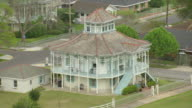 MS AERIAL TS Shot of doullut steamboat house designed similar to steamboat / New Orleans, Louisiana, United States