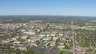 WS AERIAL Shot of downtown buildings and Missouri State campus / Springfield, Missouri, United States