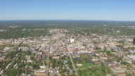 WS AERIAL Shot of downtown buildings / Springfield, Missouri, United States