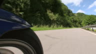 CU POV Shot of driving motorbike on country road / Kirf, Rhineland Palatinate, Germany