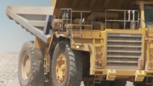 CU Shot of dump truck driving through construction site / Namibia