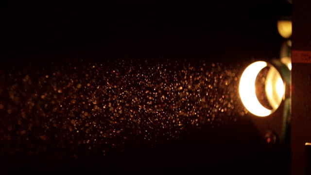 MS Shot of Dust particles catching light / London, United Kingdom