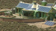 MS AERIAL ZI Shot of Earthships house made of natural and recycled materials in Taos County / New Mexico, United States