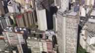 MS AERIAL Shot of Edifice Italia and Edifice Copan around city / Sao Paulo, Brazil