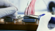 CU PAN shot of electronic component being soldered / London, United Kingdom