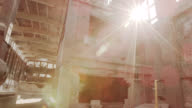 'WS PAN SLO MO Shot of empty abandoned factory with sun flooding through windows / Berlin, Germany'