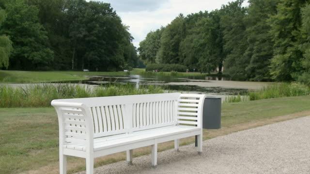 MS Shot of empty bench in park of Ludwigslust Castle / Ludwigslust, Mecklenburg Vorpommern, Germany