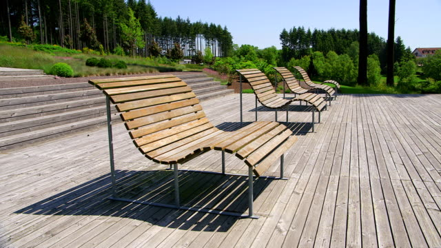 WS Shot of empty benches in park / Losheim, Saarland, Germany