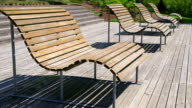 MS Shot of empty benches in park / Losheim, Saarland, Germany