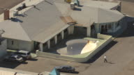 MS AERIAL Shot of empty pool and motel room doors at Desert Sands Motel / Albuquerque, New Mexico, United States