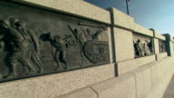 CU PAN Shot of engravings of war scenes on wall at World War II Memorial / Washington, District of Columbia, United States