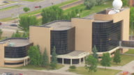 CU AERIAL TS ZO Shot of Entrance to Clifford Hall at School of Aerospace Sciences and pull out to reveal building / Grand Forks, North Dakota, United States