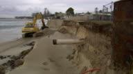 MS TS Shot of Excavator digging near sandbag / Kingscliff, New South Wales, Australia