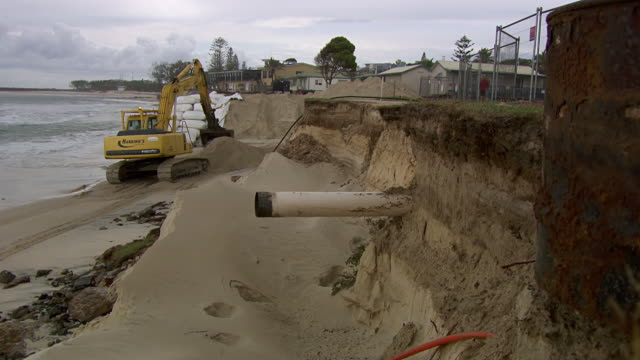 MS TS Shot of Excavator digging near sandbag / Kingscliff, New South Wales, Australia