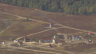 MS AERIAL Shot of exercise village for military training camp with landscape / Germany