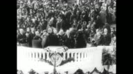 Shot of exterior of US Capitol / overhead shot of crowd gathered in front of Capitol for Inauguration Ceremony / overhead shot of Pres Harry Truman...