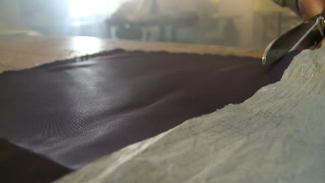 CU Shot of fabric being cut with scissors / South Africa