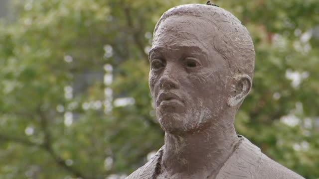 CU Shot of face of Joseph McNeill statue in rain / Greensboro, North Carolina, United States