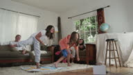 MS Shot of Family playing exercise video game / Santa Cruz, California, United States