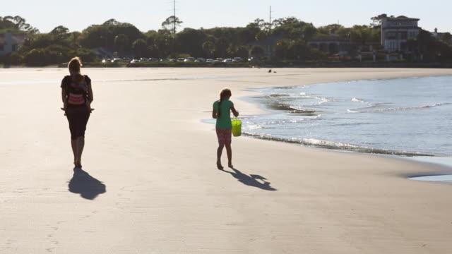 WS R/F TU Shot of family walking on beach / St Simon's Island, Georgia, United States