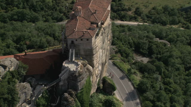 WS AERIAL DS Shot of famouse Meteora Pillars, suspended rocks (UNESCO world heritage site) / Meteora, Thessalia, Greece