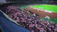 MS Shot of Fans at soccer game in Nissan Stadium / Yokohama, Kanagawa, Japan