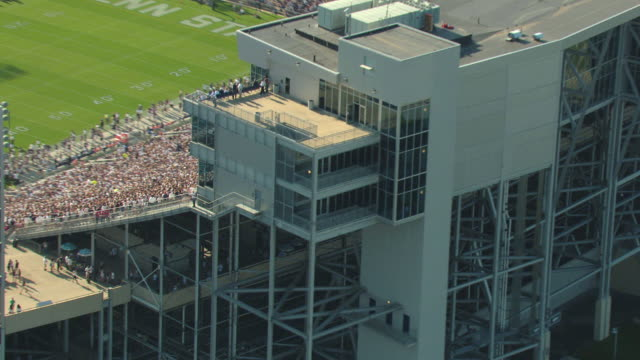 MS AERIAL ZI Shot of fans in bleachers during football game at Beaver Stadium at Pennsylvania State University / University Park, Pennsylvania, United States