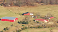 MS AERIAL Shot of Farm houses with wooded area / Georgia, United States