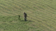 MS Shot of farmers hay turning / Schwende, Appenzell Innerhoden, Switzerland