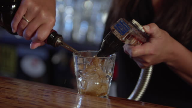 CU SLO MO Shot of female bartender making serving drink / Seattle, Washington, United States