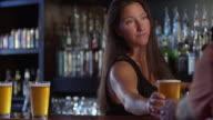 MS SLO MO Shot of female bartender serving beer / Seattle, Washington, United States