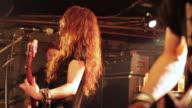 MS Shot of female guitarist singing on stage / Shimokitazawa, Tokyo, Japan