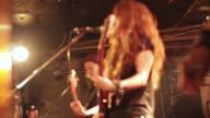 MS R/F Shot of female guitarist singing on stage / Shimokitazawa, Tokyo, Japan