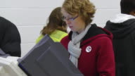 MS Shot of female voter casts ballot at copmuter terminal during voting in presidential election / Sylvania, Ohio, United States